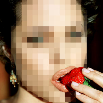 Pixelated Angelina Jolie face eating strawberry